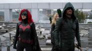 Green Arrow, Mia Smoak and Batwoman fighting to save Earth-38