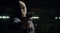 Slade in his old mask pointing a gun.png