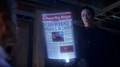 Eobard shows Eddie a future newspaper.png