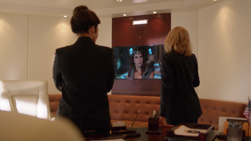 Cat Grant and President Marsdin speak with Rhea