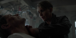 Kate tried to save August after he stabbed his own throat