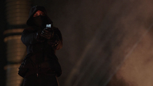 Dinah pointing a gun