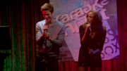 Barry and Caitlin sing in karaoke