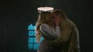 Sara kissing John