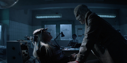 Luke is forced to watch as Julia is tortured by Hush