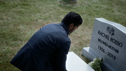 Ramsey in front of his mother's grave