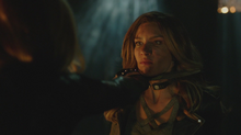 Dinah held at knife point by Black Siren