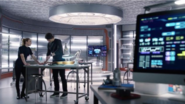 Ray and Sara talk in his lab
