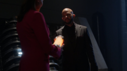 Lex gives the Leviathan bottle to Lillian