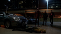 The Flash, Firestorm, and The Arrow stand over a defeated Reverse-Flash.png