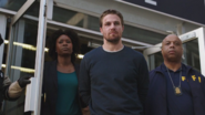 Oliver Queen escorted out of the precinct