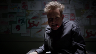 James Jesse Trickster in prison with a wall full of Flash death drawings