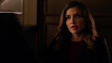 Dinah on the stand trying to help Oliver