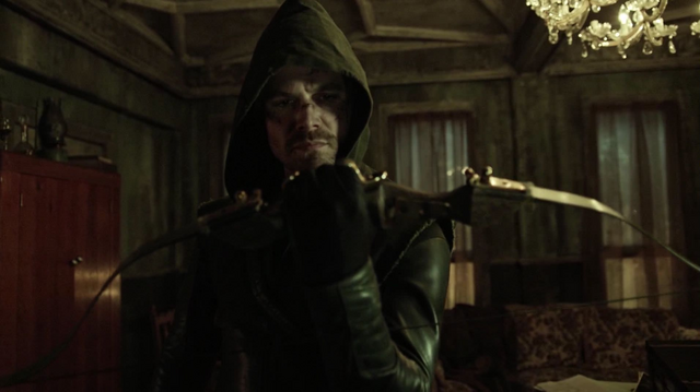 File:Oliver dons his vigilante suit for the first time.png