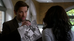 Mason showing an image of what occurred during the CC Jitters shooting to Iris