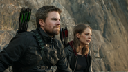 Oliver and Thea on a cliff