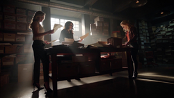 Dinah Laurel and Felicity go through files