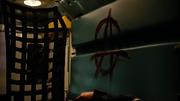 Lonnie Machin leaves an anarchist symbol behind