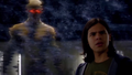 Eobard Thawne's Reverse-Flash hologram behind Cisco Ramon.png