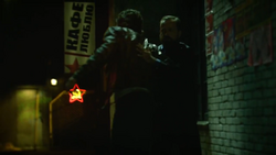 Cafe Lyublyu sign behind Oliver Queen and Anatoly Knyazev