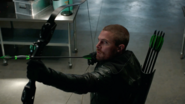 Oliver aiming his bow with an explosive arrow