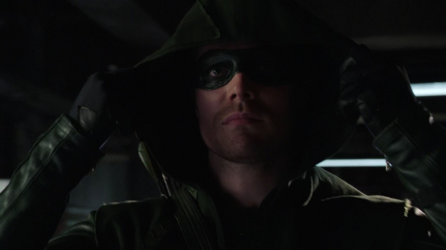 File:Oliver dons The Arrow's mask for the first time.png