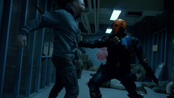 Deathstroke fights Jackal mercenaries