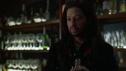 Lex posing as a bartender