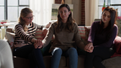 Kara, Lena and Sam hold hands