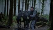 Slade, Oliver, Shado and Yao escape from Fyers