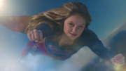 Supergirl pushing her endurace