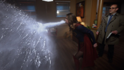 Supergirl saving Snapper from Biomax