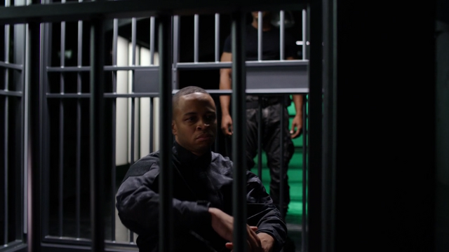 File:Diggle talks to his brother Andy.png