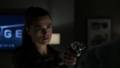 Lena Luthor points a gun at Morgan Edge.png