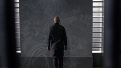 Lex engrave a bass-relief on his cell's wall