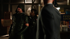 Lance watches as Liza Warner holds the Green Arrow hostage