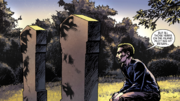 Oliver kneels over the grave of his father and his grave