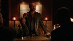 Anatoly greets Oliver and Diggle in his office