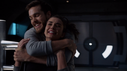 Mon-El and Imra play fighting