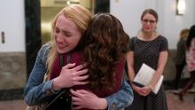 Regina hugs her daughter Izzy