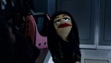 Zari Tomaz as a puppet