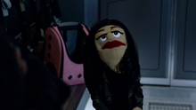 Zari Tomaz as a puppet