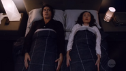 Ray and Nora awkwardly share a bed