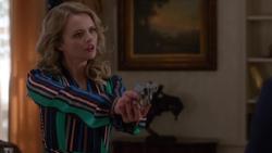 Eve holds Lena at gunpoint