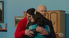 Ray joins Nora and Damien's hug