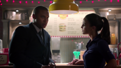 Diggle talks to Carly about his job