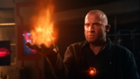 Mick Rory wields the Fire totem against the Mallus-possessed, Death totem-powered Sara Lance
