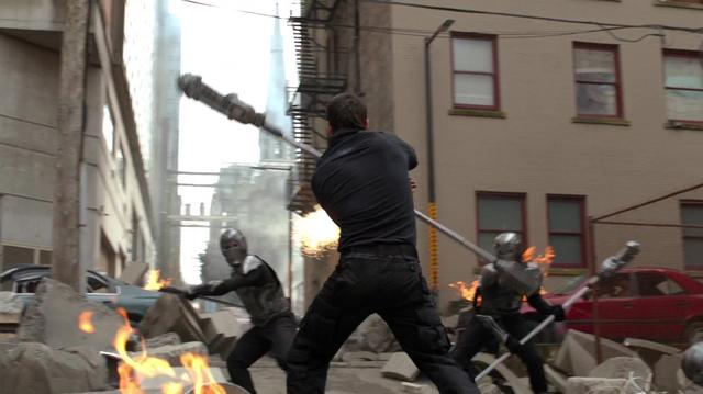 File:Mon-El defending National City.png