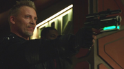 John Valor holds Rip Hunter at gunpoint
