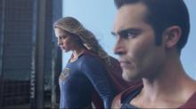 Supergirl and Superman flying together